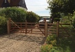 Hardwood gates treated in light brown